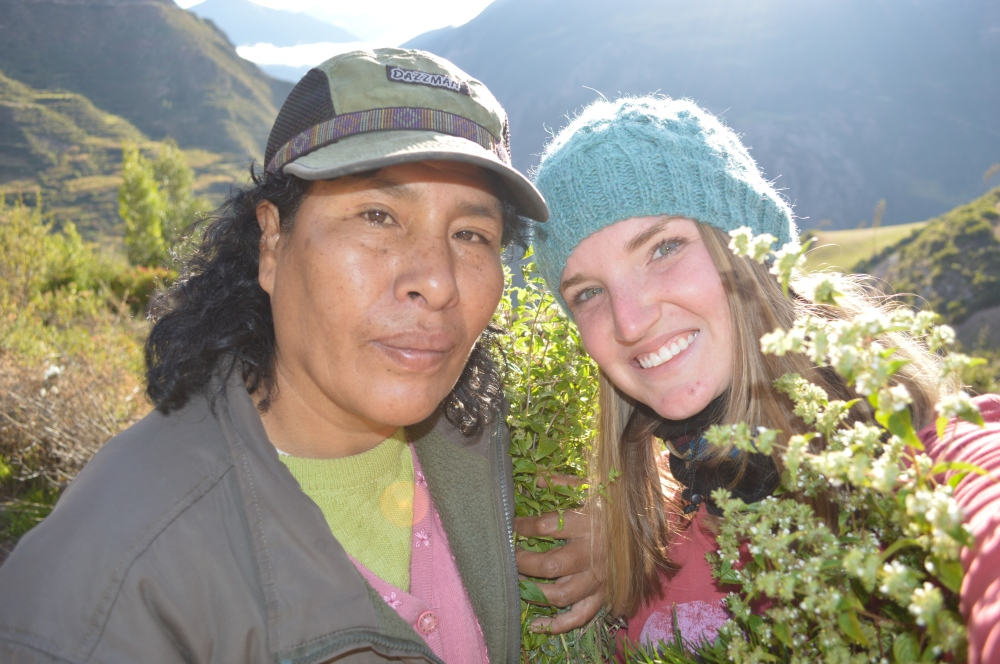 Community Coordinators Escolastica and Jenny gathering herbs in the early morning.