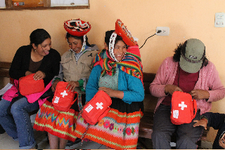 Promotoras with their botiquines, or bags of supplies.